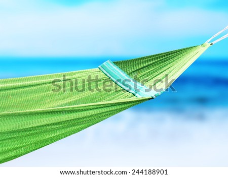 Green hammock hanging in the coast - stock photo