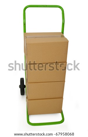 Green hand truck with four cardboard boxes on it ready for delivery - stock photo