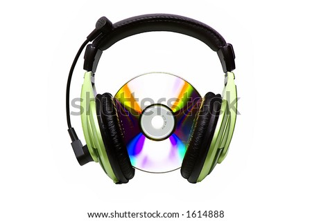 Green headphones and CD - stock photo