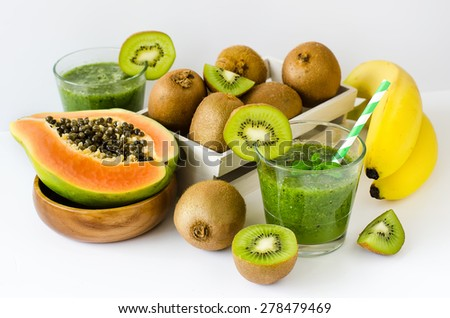 Green healthy kiwi tropical fruits smoothie with papaya and bananas