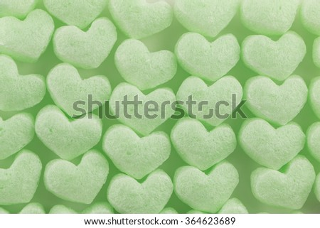 green  heart of buffer packaging  material for web page background - stock photo