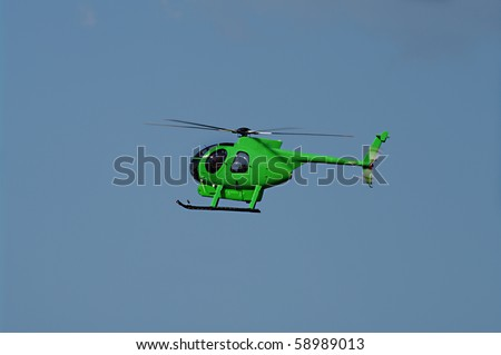 Green helicopter in flight