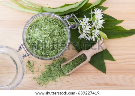 Green herbal salt of wild garlic and wooden spoon / herbal salt and wild garlic / herbal salt