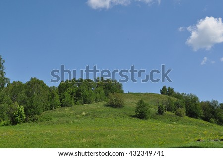 Green hill and beautiful blue sky - stock photo