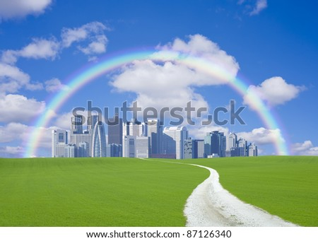 Green hill and clouds with rainbow