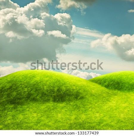 Green hills and a blue sky