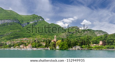 Green hills and coast of Lake Como at Tremezzo in June, seen from Bellagio