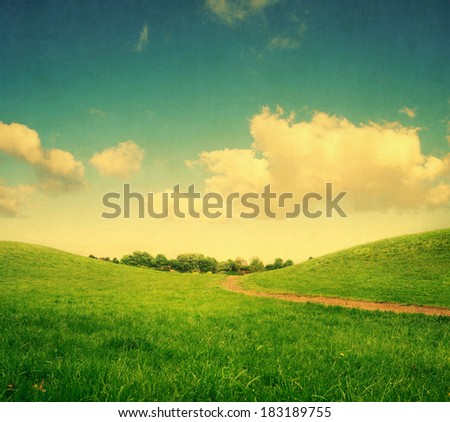 green hills and lane to remote trees, landscape with vintage colors - stock photo