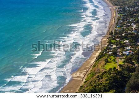 green hills and sea landscape, location - Kapiti Island coastline, North Island, New Zealand - stock photo
