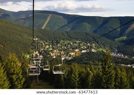 Green Hills and the town Spindleruv mlyn - stock photo