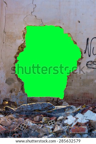Green hole on a wall - stock photo