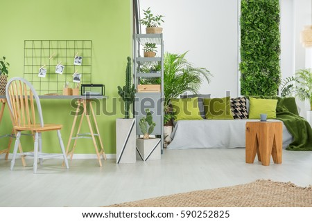 Green home interior with sofa, desk, chair and metal bookcase - Bookcase Stock Images, Royalty-Free Images & Vectors Shutterstock