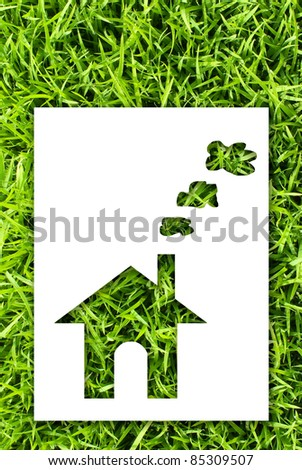 Green house concept. paper house on fresh grass land. - stock photo