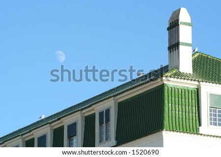 Green house on a blue sky