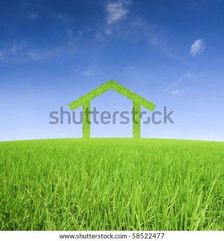 green house on a green meadow concept photo - stock photo