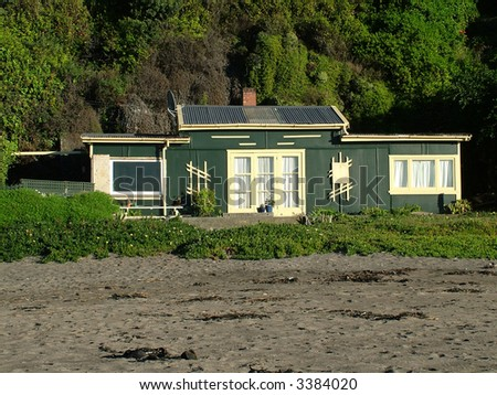 Green house on the beach - stock photo