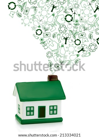 green house with eco icons out of  chimney,  not polluting the environment, concept �¢?? eco chimney - stock photo