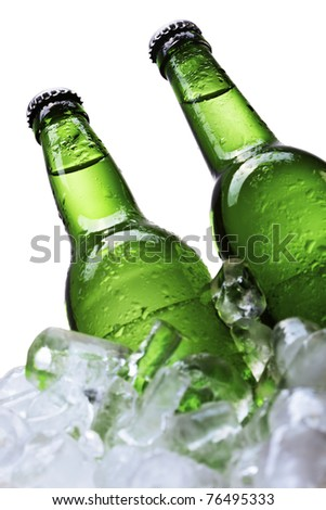 Green ice beer bottles over white background - stock photo