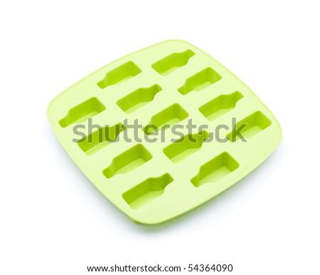 Green ice tray isolated on white background - stock photo