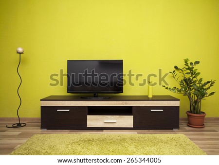 Green interior of a living room - stock photo