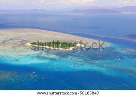 Green Island at Great Barrier Reef near Cairns Australia seen from above - stock photo