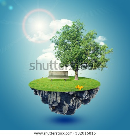 Green island with tree and bench on blue sky background