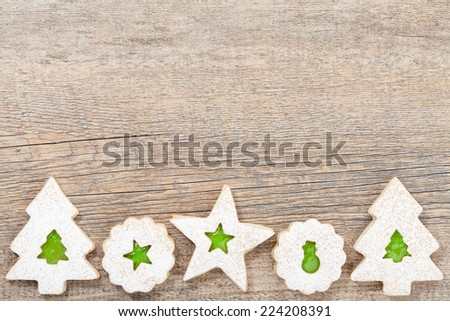 Green jam filled Christmas Linzer cookies  - stock photo