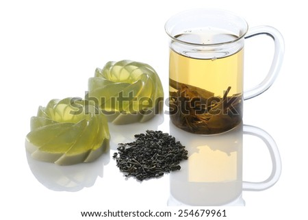green jelly dessert, green tea close-up on white background isolate - stock photo