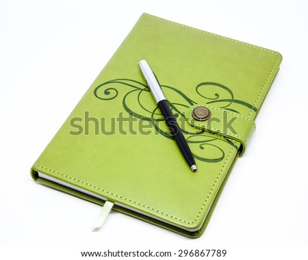 Green journal and pen 2; isolated - stock photo