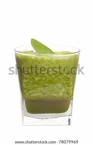 Green juice - focus on green leaf - stock photo