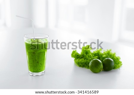 Green Juice. Healthy Eating. Juicing Cold Pressed Vegetable Smoothie For A Detox Diet. Healthy Drink, Meal, Food, Diet Concept. Vitamins. Fitness And Healthy Lifestyle Concept. - stock photo