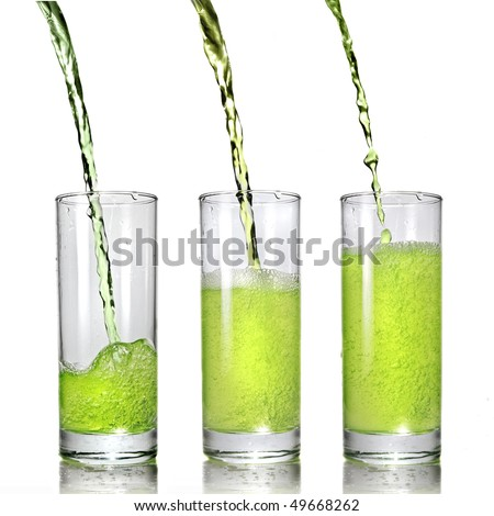 green juice pouring into glass isolated on white - stock photo