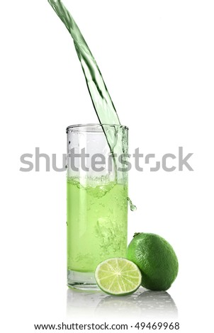 green juice with lime pouring into glass isolated on white - stock photo