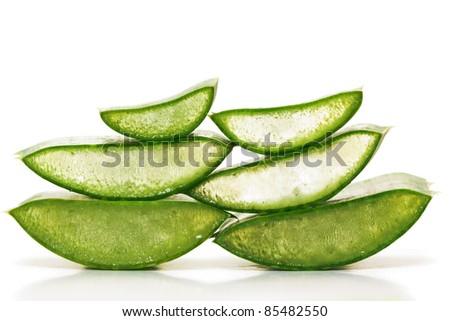 Green juicy slices of aloe vera isolated on white. Photo taken on: September 27th, 2011 - stock photo