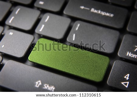 Green key on laptop keyboard with blank space. Included clipping path, so you can easily edit it and include your own color, text or icon. - stock photo