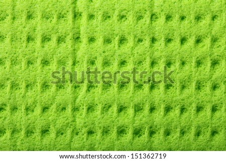 Green kitchen sponge rubber foam as background texture - stock photo