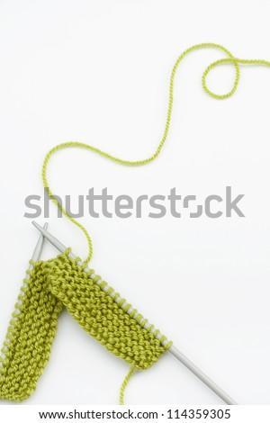 Green knitting wool and knitting needles - stock photo