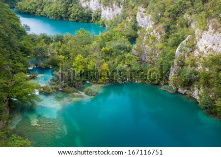 Green lake between big canyon located in Plitvice National Park - stock photo