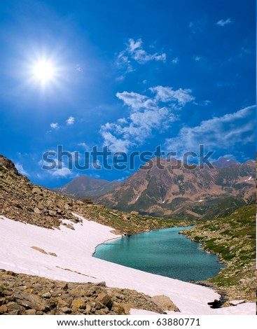 green lake in a winter mountains - stock photo
