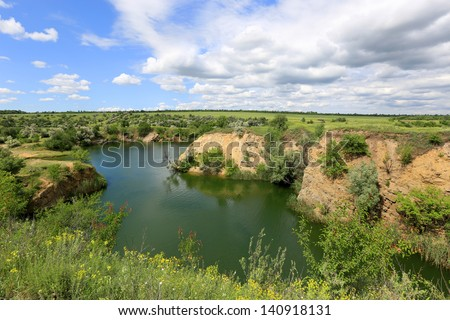 Green lake in steppe in nice summer day - stock photo