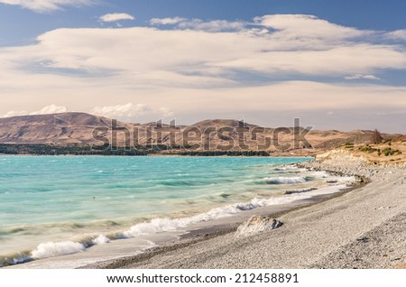 green lake Pukaki shore, New Zealand - stock photo