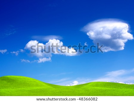 Green landscape and cloudy sky - stock photo