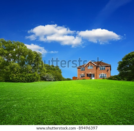 Green landscape and new house - stock photo