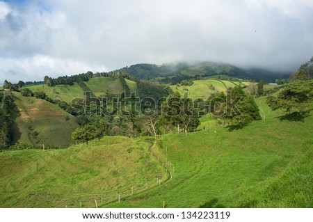 Green landscape in inland Costa Rican  highlands - stock photo