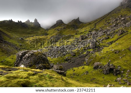 Green landscape of Scotland. Behind the Old man of Storr on the Isle of Skye