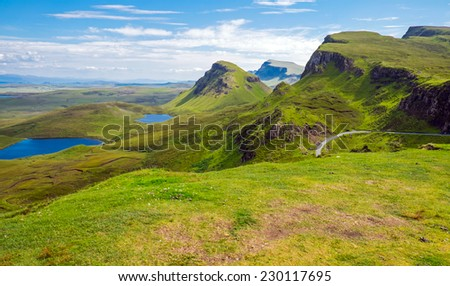 Green landscape on the Isle of Skye in Scotland - stock photo