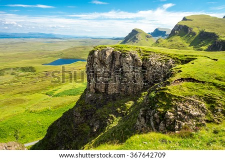 Green landscape on the Isle of Skye, Scotland - stock photo