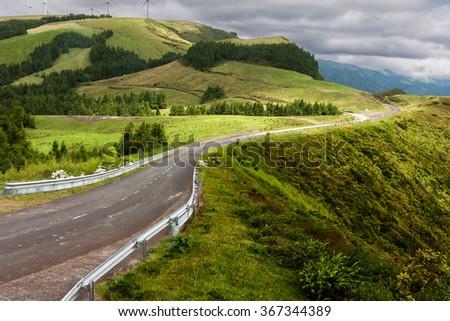 Green landscape on top of Miradouro do Salto do Cavalo in Sao Miguel, Azores Islands - stock photo