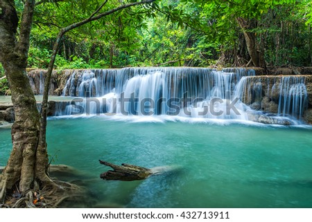 Green landscape with green waterfall at Erawan waterfall , Beauitful and very nice waterfall for relaxation, Erawan waterfall loacated Kanjanaburi Province , Thailand - stock photo
