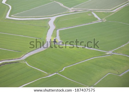 Green landscape with water and windmill from above, The Netherlands - stock photo